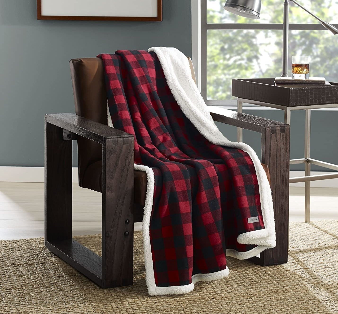 A cozy flannel blanket draping over a big chair