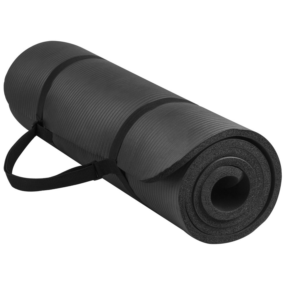 a black yoga mat wrapped in its carrying strap
