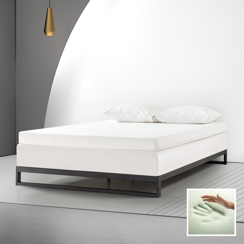a white mattress topper on a mattress in a bedroom