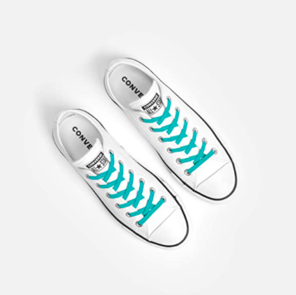 A pair of Converse sneakers with the no-tie laces on them