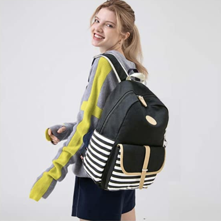 A model carrying the backpack over their shoulder, showing that it's a pretty average size