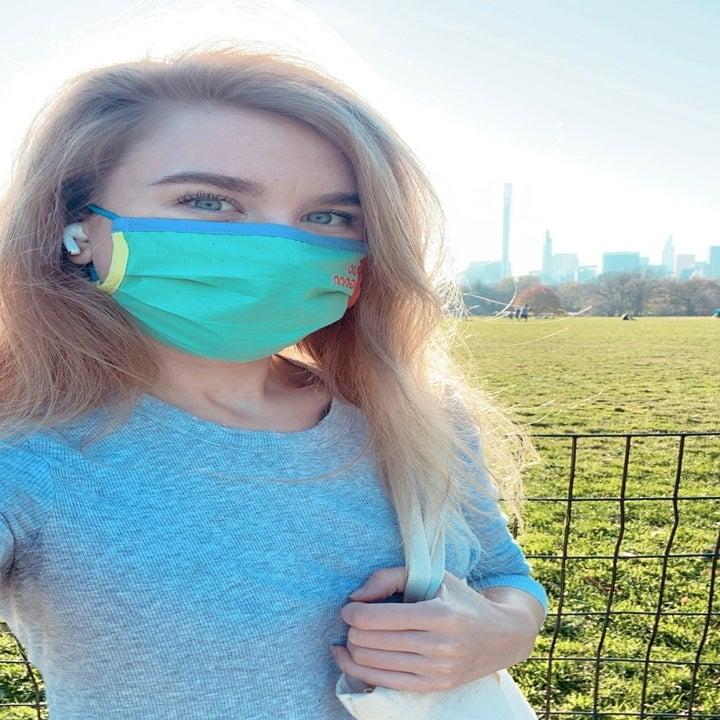 Editor Emma Lord wearing blue mask