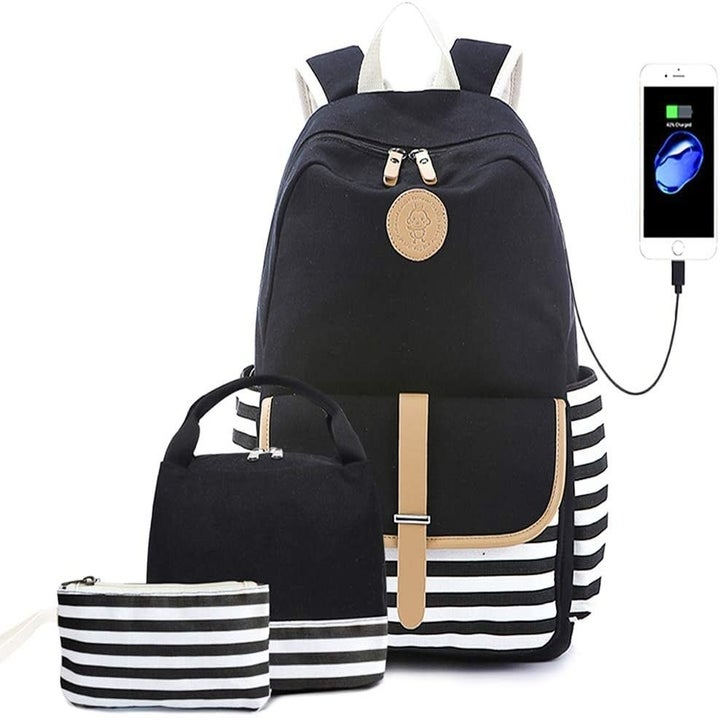 The black backpack, lunchbox, and pencil pouch, with black and white stripes on the bottom
