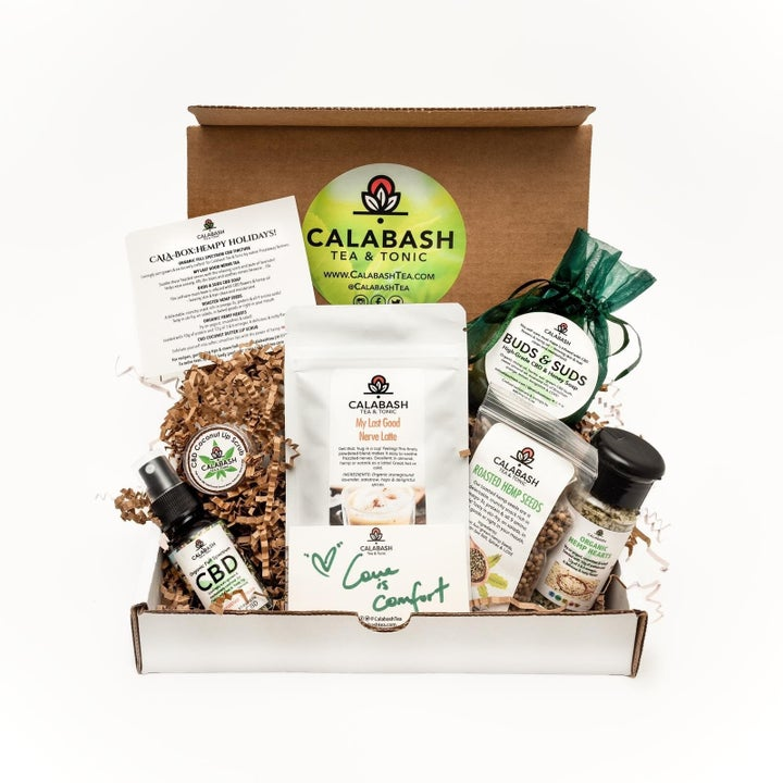A gift box of products including tea, spices, and CBD soap.