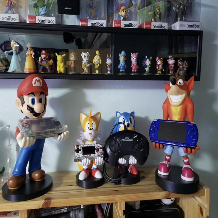 A reviewer's collection of controller holders