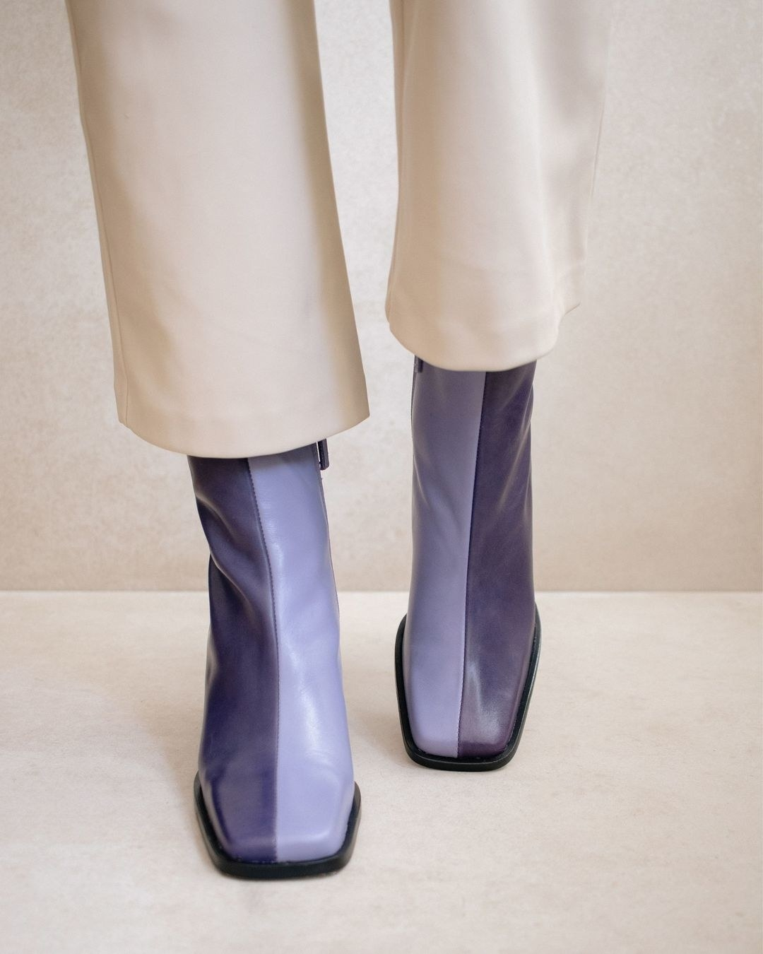 The two-tone purple boots with black soles