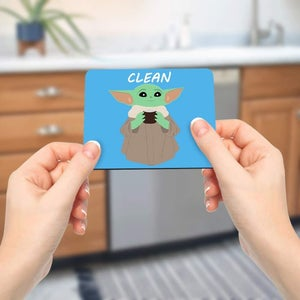 Model holding the magnet near the dishwasher