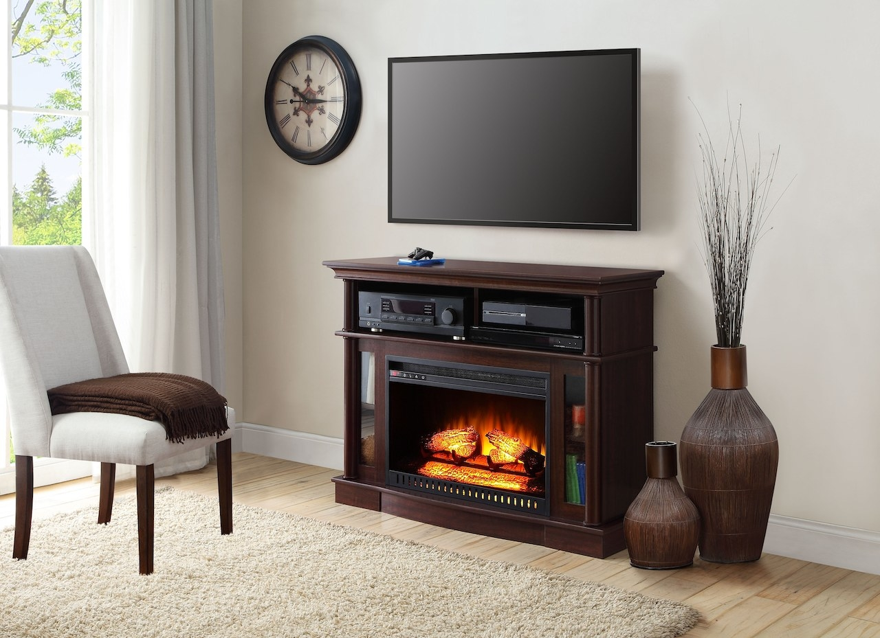 The TV console in a living room with the electric fire turned on