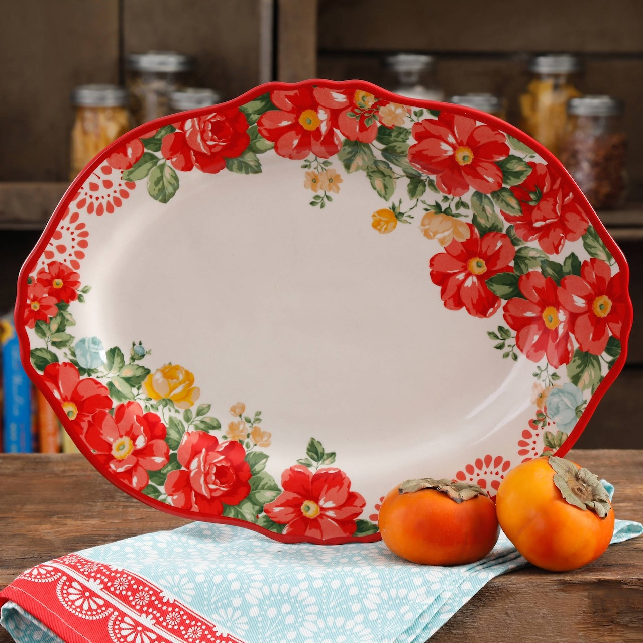 The oval platter with a red floral print around the edges