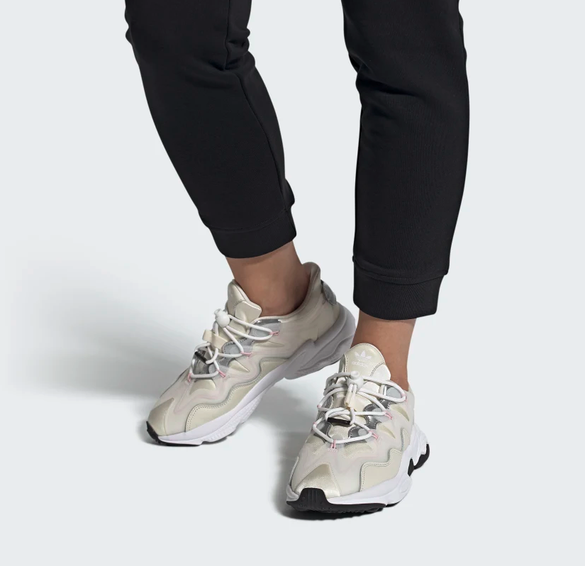 Ozweego plus sneakers in off-white, pink, and silver