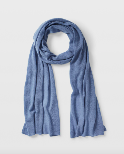 A cashmere scarf curled up on a blank background