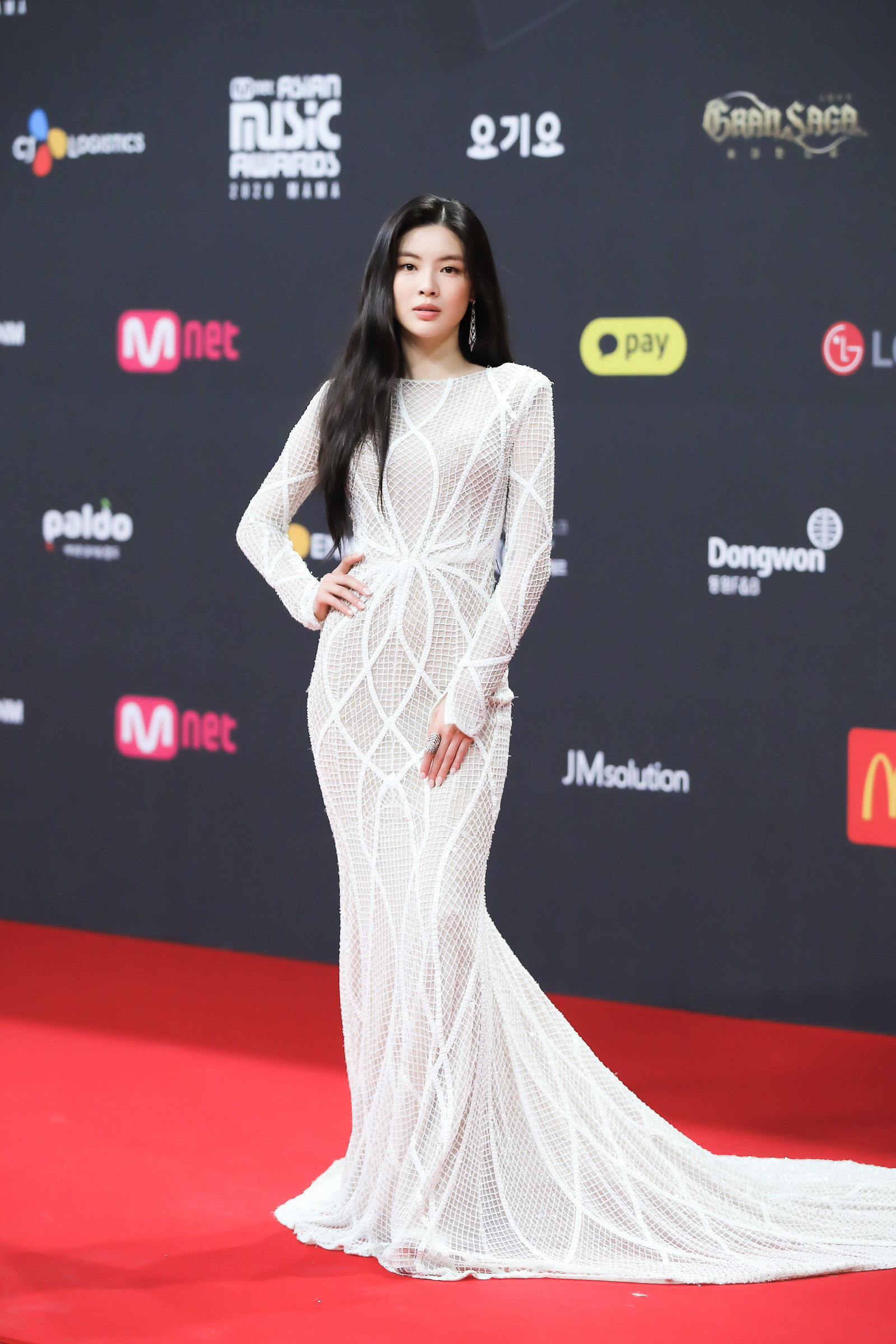 Lee Sun Bin wears a floor-length mesh dress with a train at the 2020 Mnet Asian Music Awards