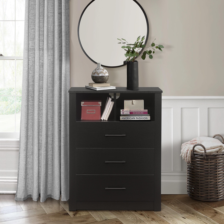 The black dresser in a bedroom