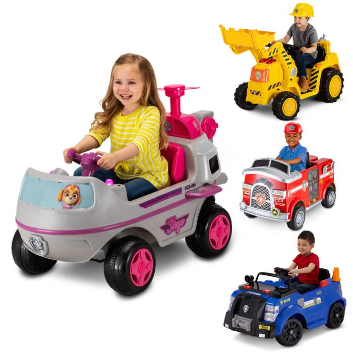 Children riding in the brightly colored cars