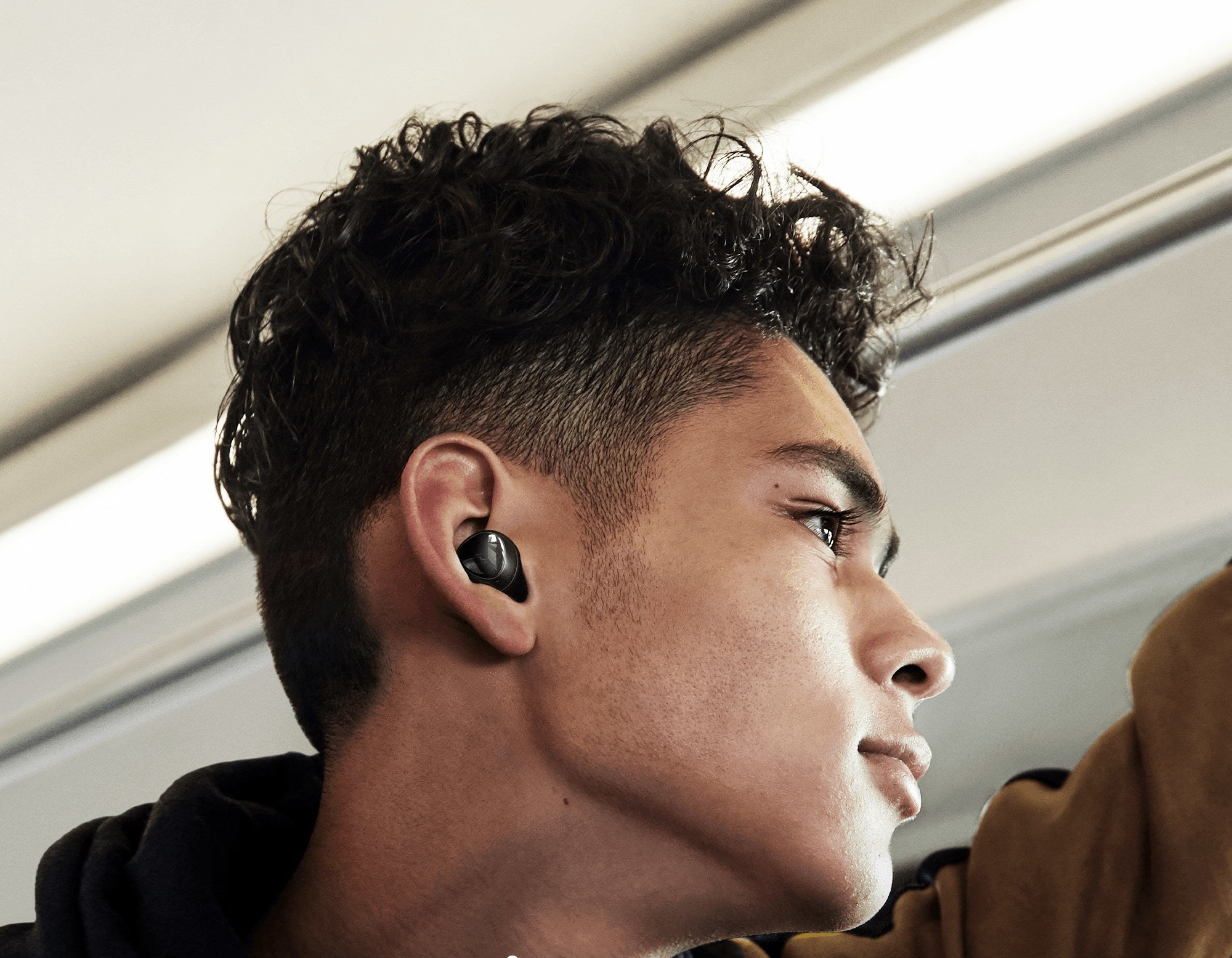 A model wearing the earbuds