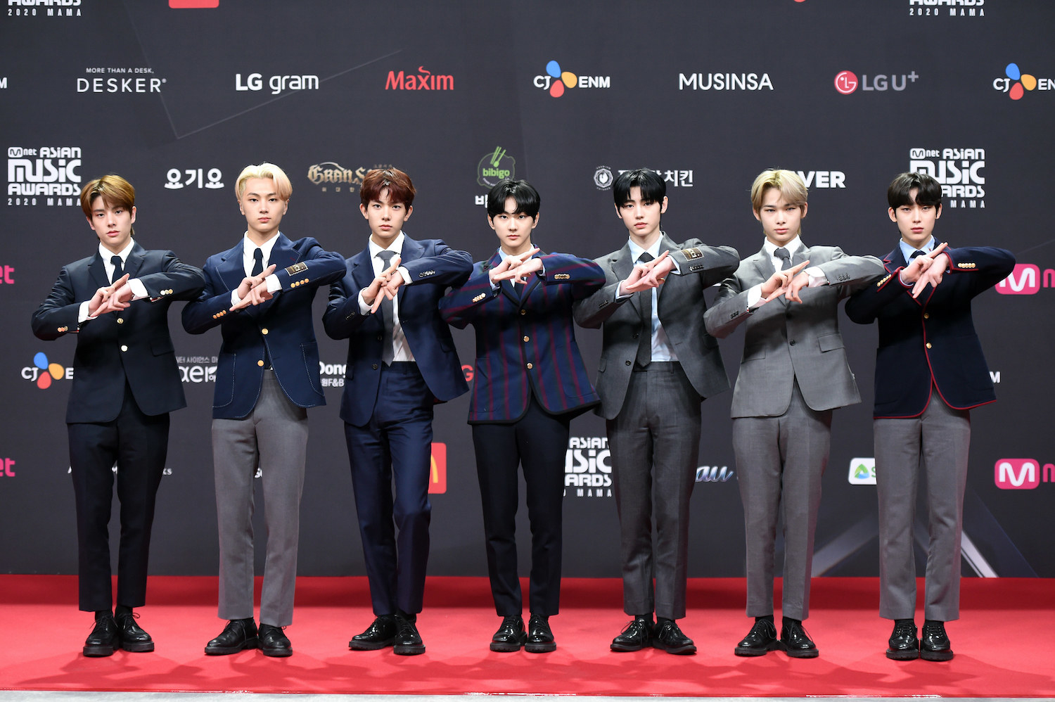Enhypen, wearing suits, attends the 2020 Mnet Asian Music Awards
