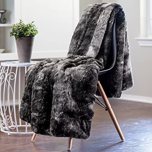 gray blanket hanging over a chair