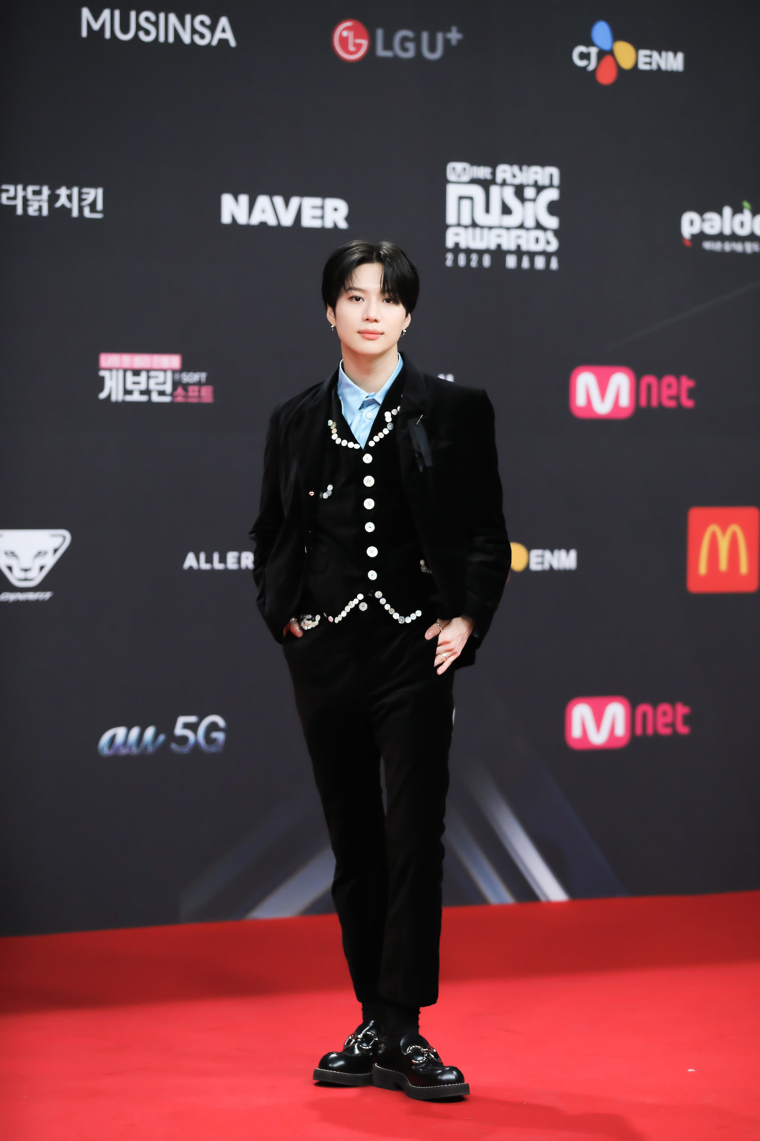 Taemin, wearing a velvet suiit, attends the 2020 Mnet Asian Music Awards