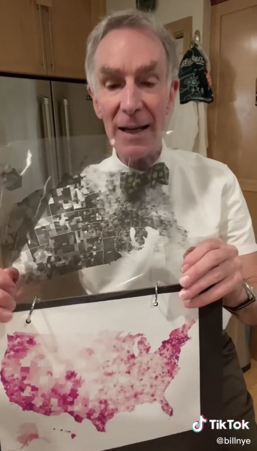 Bill Nye in front of a map with highlighted red areas