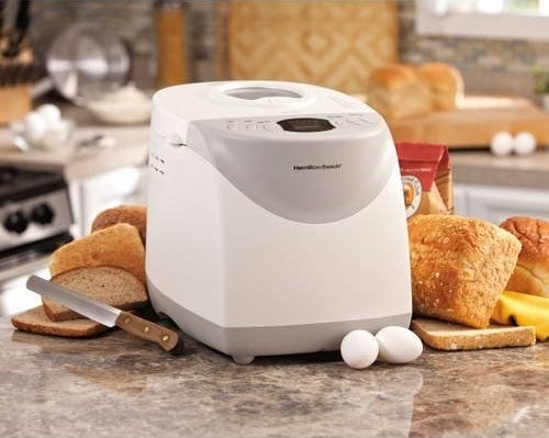 The bread maker in a kitchen with bread and ingredients