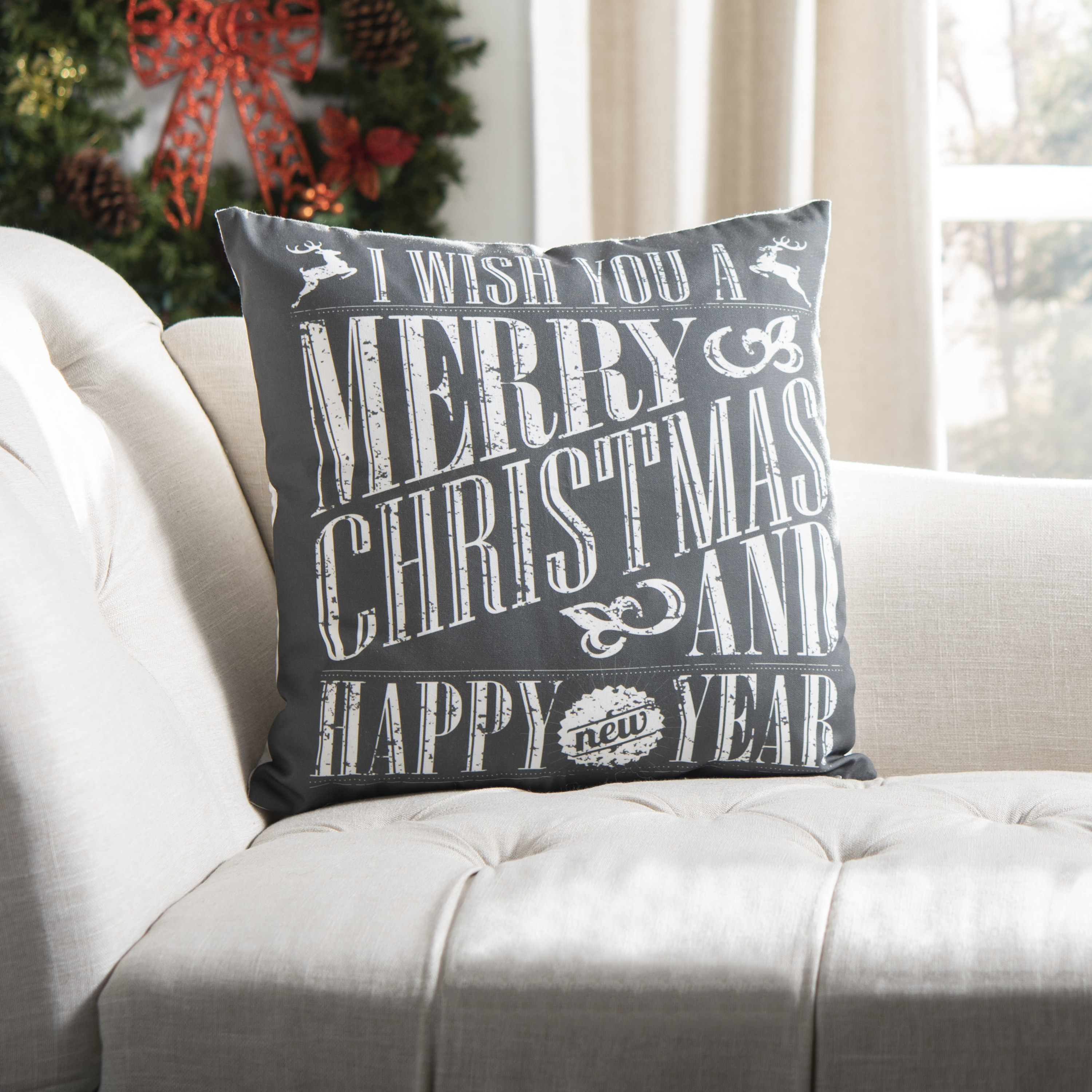 The holiday pillow on a couch