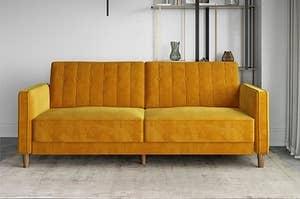 Yellow velvet couch
