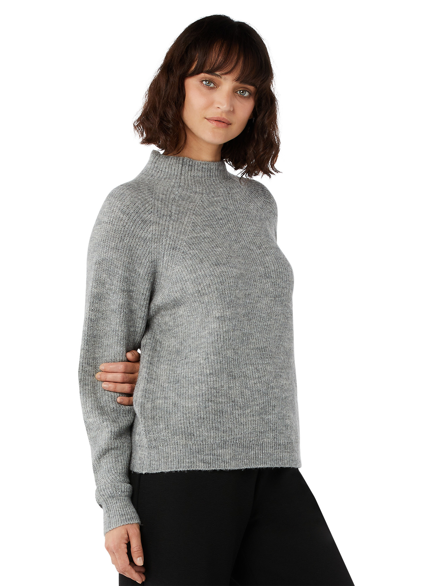 A model in the gray sweater