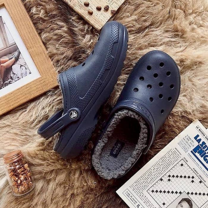 The Crocs on a faux fur rug