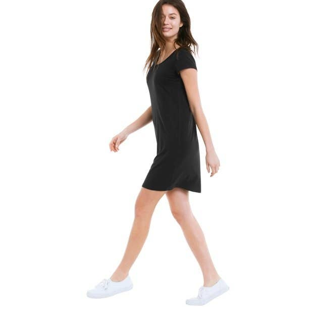 Model in a black t shirt dress