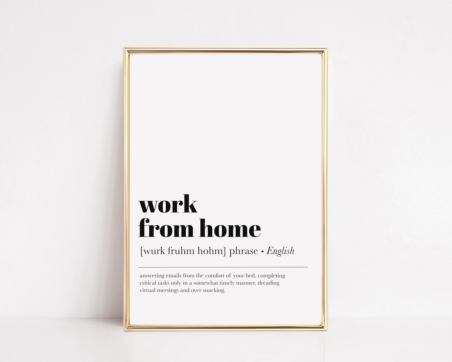 """A minimalist print that says """"work from home"""" with the definition: """"answering emails from the comfort of your bed, completing critical tasks only in a somewhat timely manner, dreading virtual meetings and over snacking"""""""