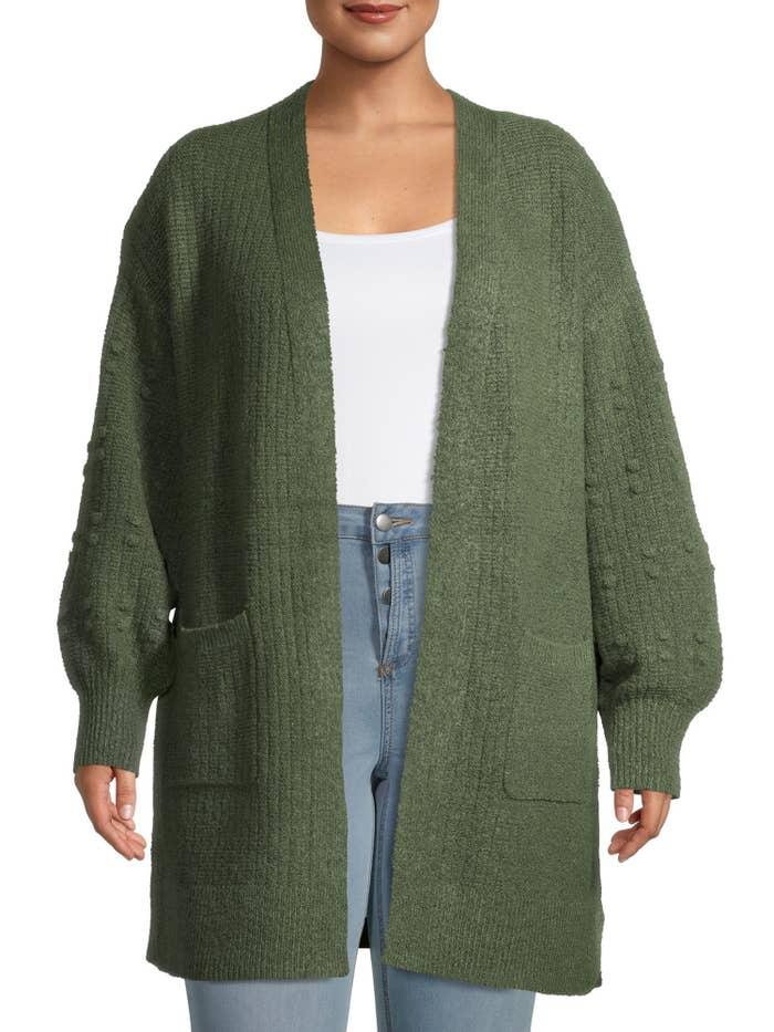 The green cardigan sweater