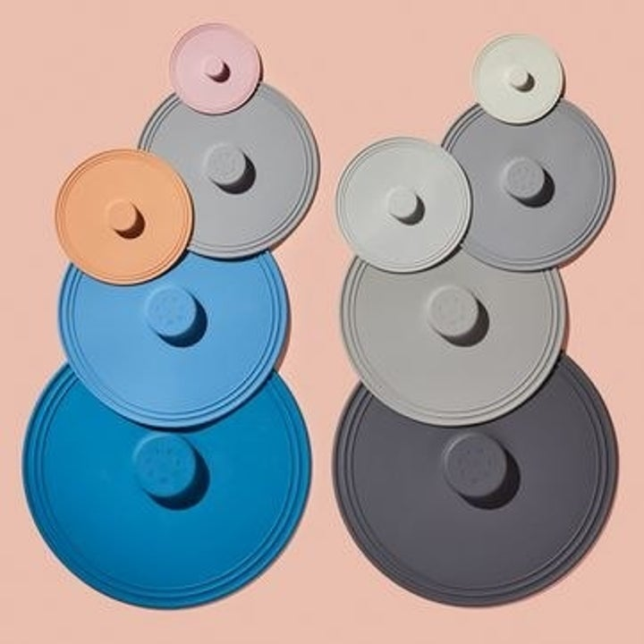 Two stacks of five different-colored silicone lids each