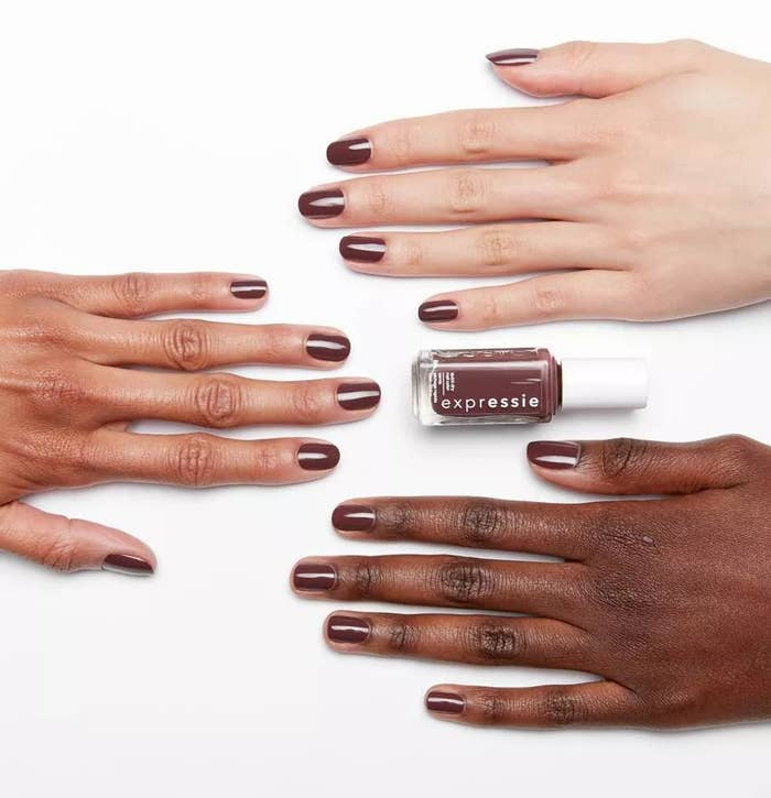 "The dark purple ""Scoot Scoot"" polish against three different skin tones"