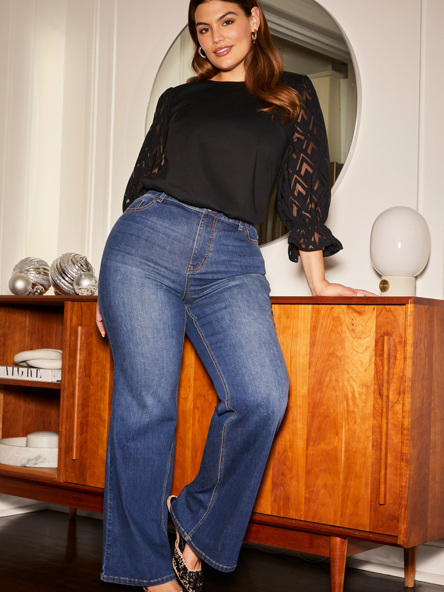 A model wearing the flare jeans