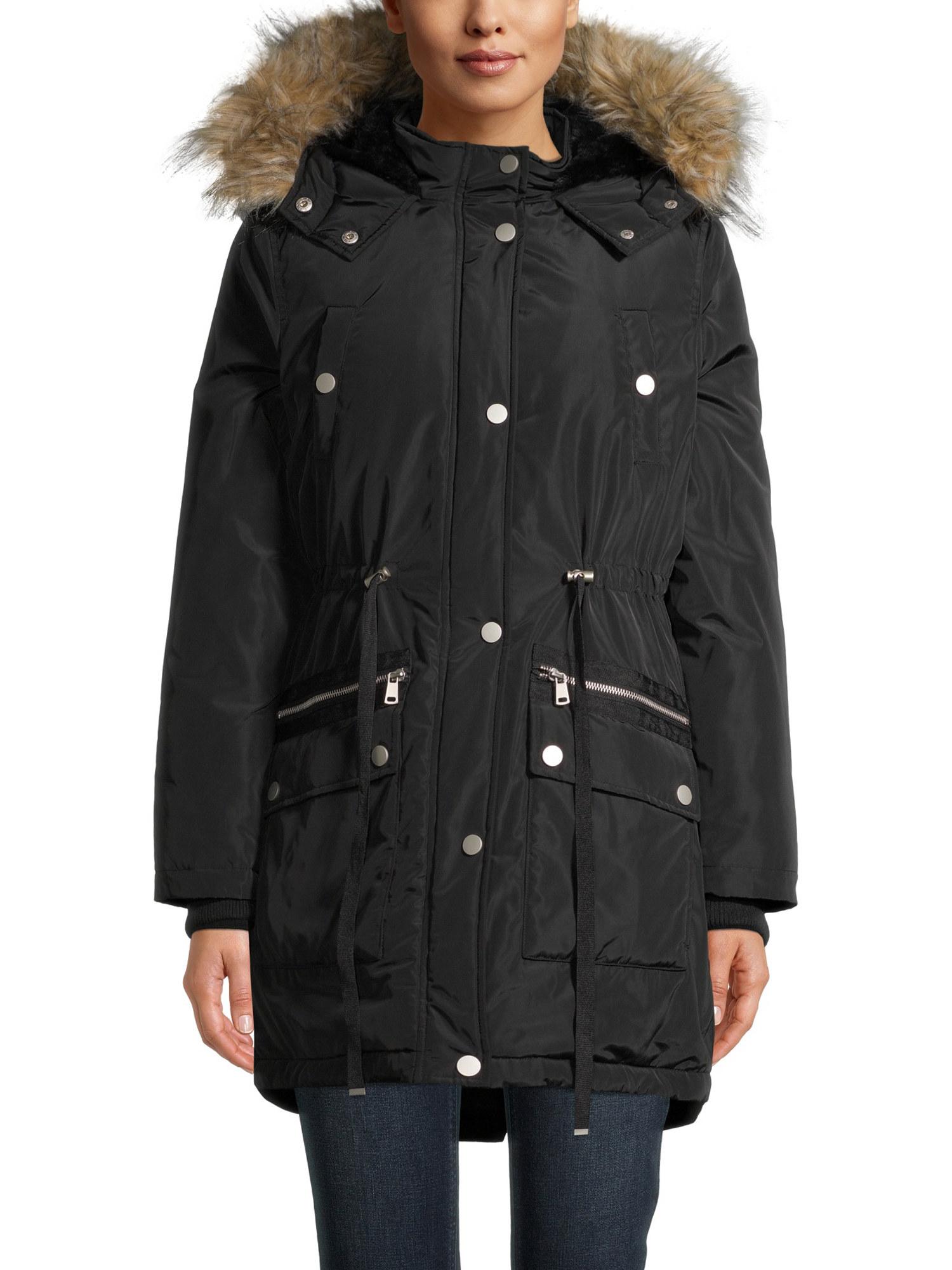 Model wearing the rich black anorak coat