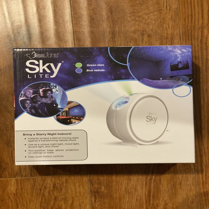 A Sky Lite brand blue light projector in its box