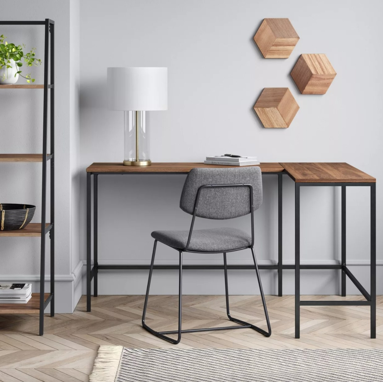 An L-shaped desk with metal frame and wood top