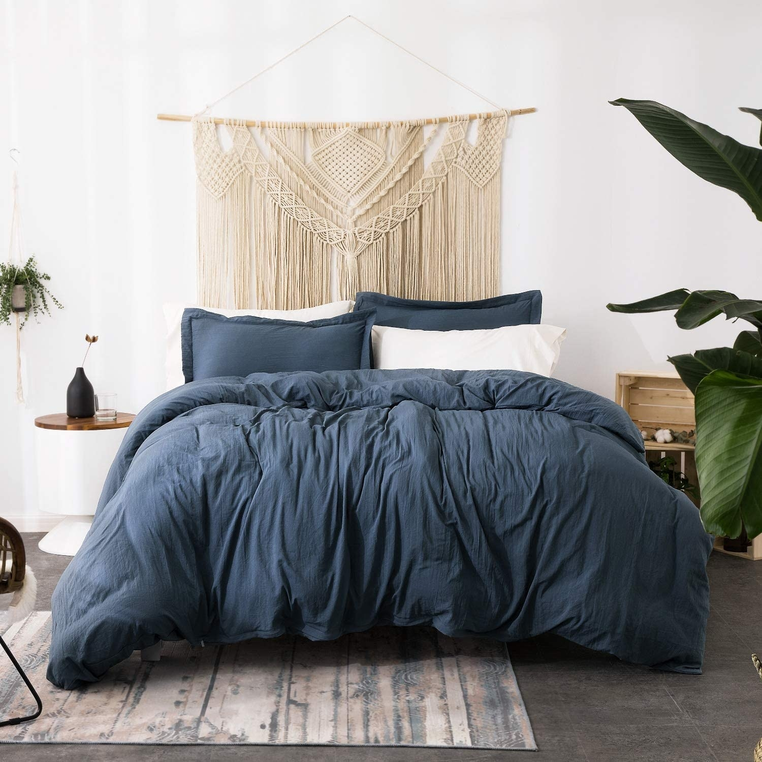 The bedding on a bed in a boho bedroom