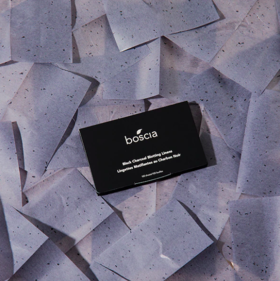 A packet of blotting linens on a bed of charcoal-infused blotting linens