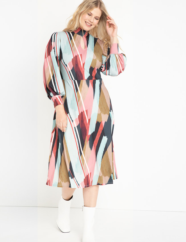 Model wearing the mid-calf length dress with puff sleeves, a key hole detailing in the center and light blue, navy, pink, and white line pattern to it