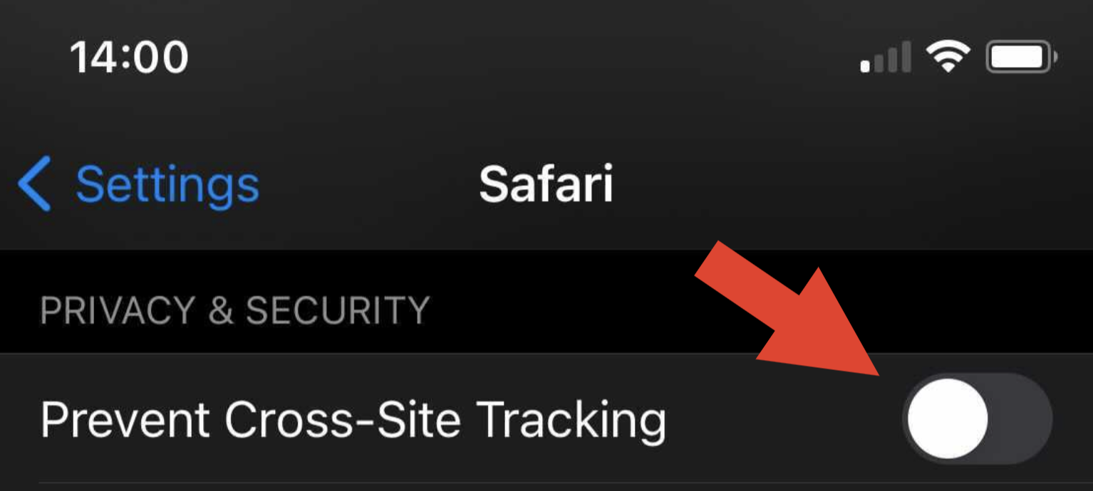 Photo of a phone with arrow pointing to the tick button on Safari.