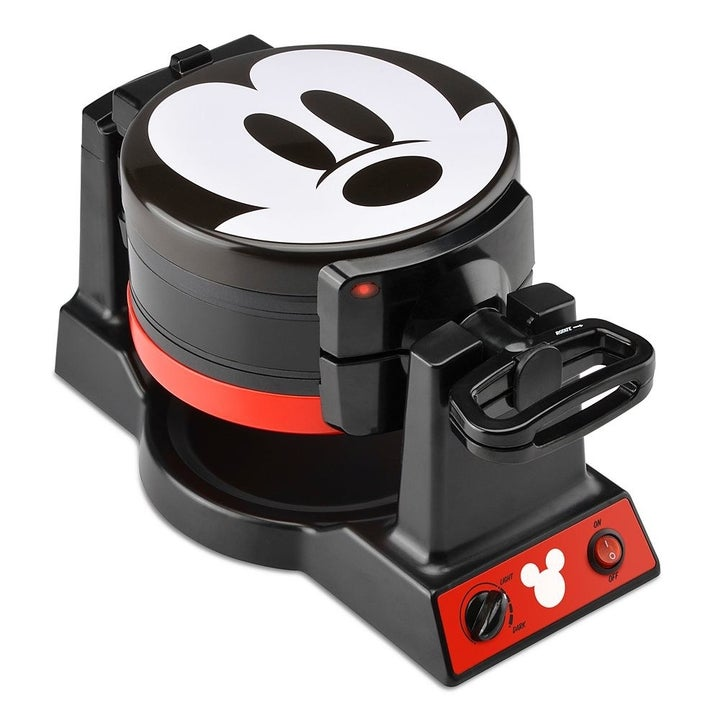 A closed waffle maker with the face of Mickey Mouse printed on the top