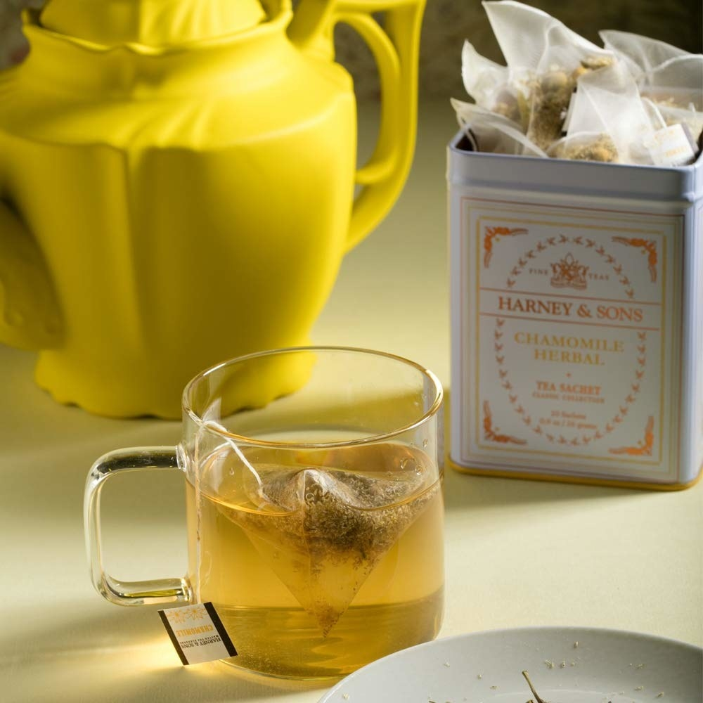 a glass mug of chamomile tea