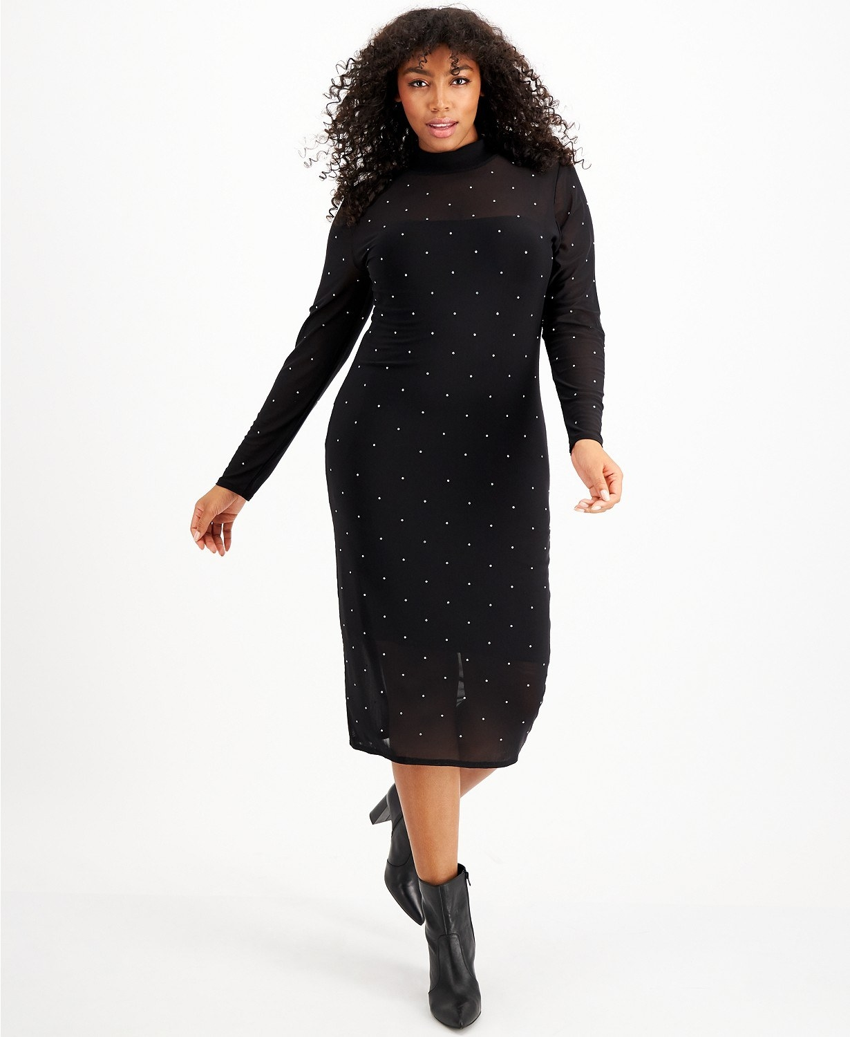 Model wearing the mid-calf length long-sleeved mesh dress with small crystals all over it