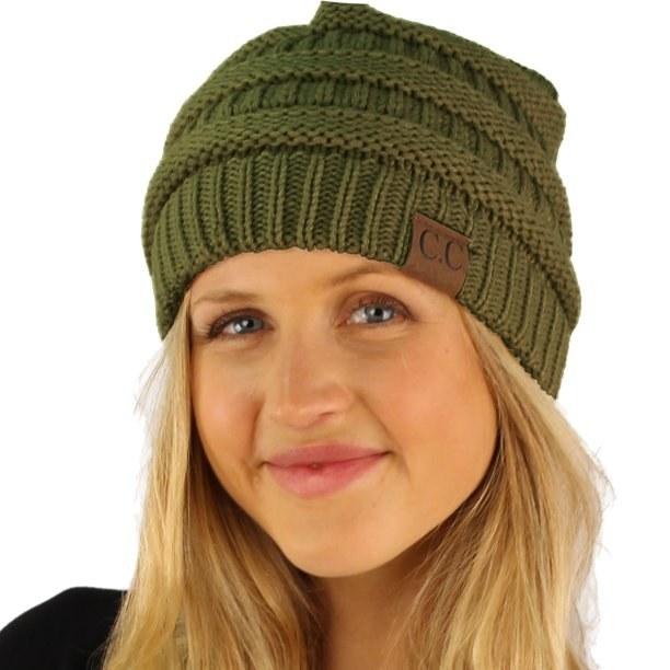 Model wearing green beanie