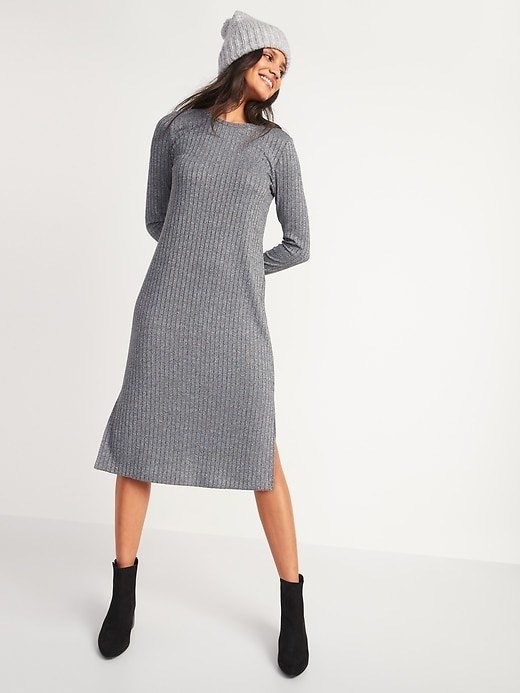 Model wearing the knee-length ribbed dress with slits up the sides in grey