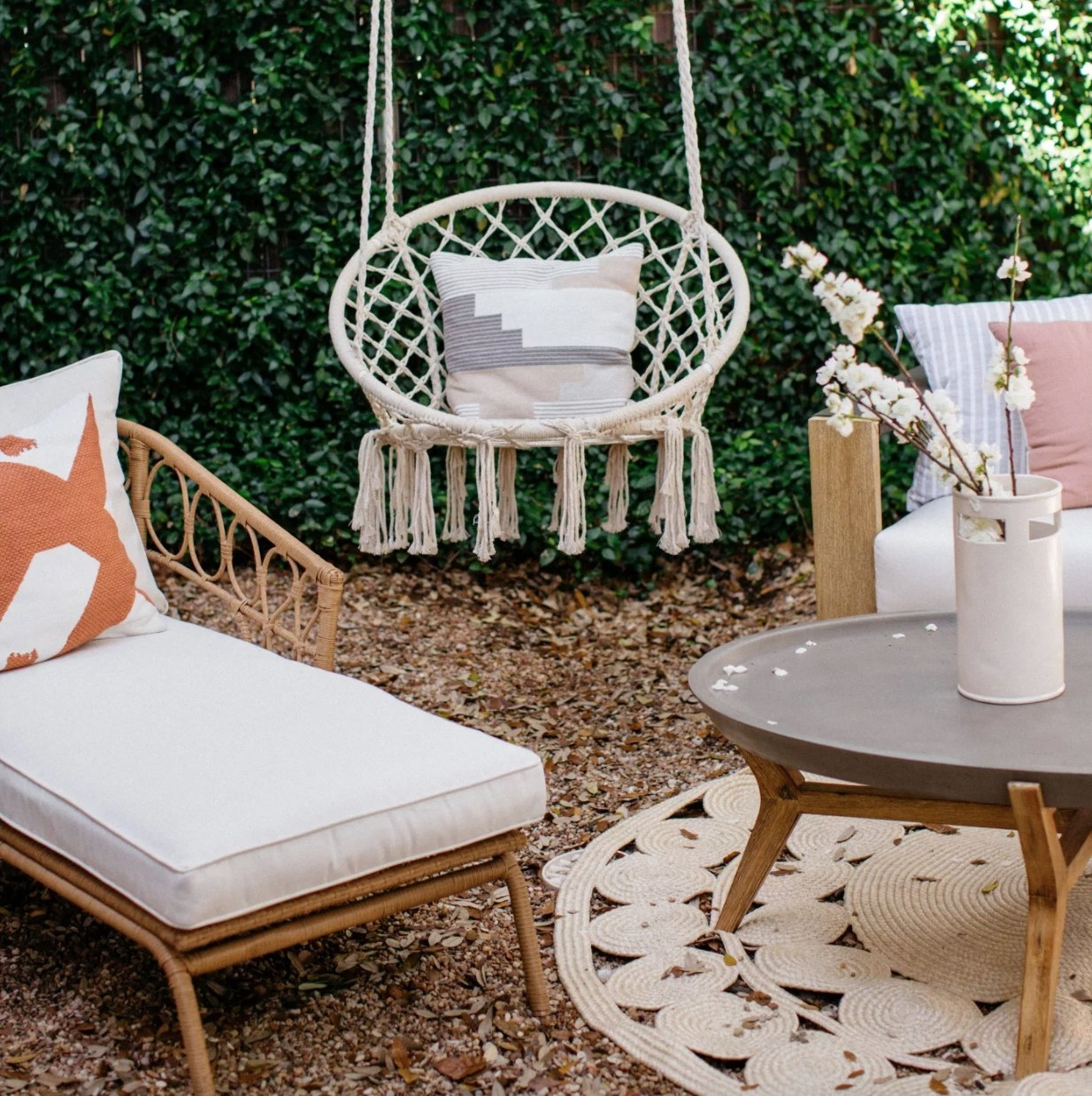 A white macrame hanging chair