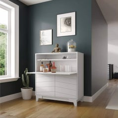A white fold-down bar with storage cabinets