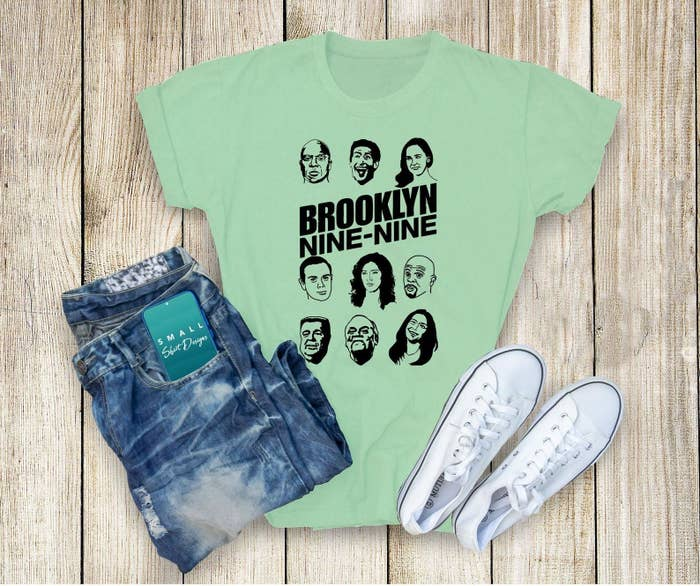 A tee with the logo and drawings of the main cast's faces