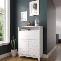 A white fold-down desk with storage cabinets